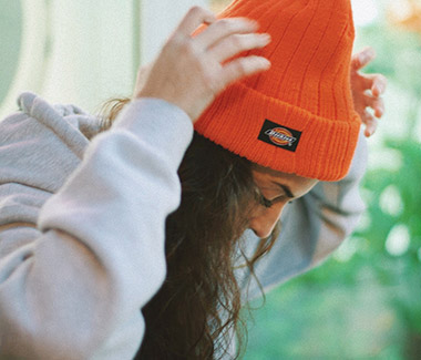 V-Webs wearing an orange Dickies beanie