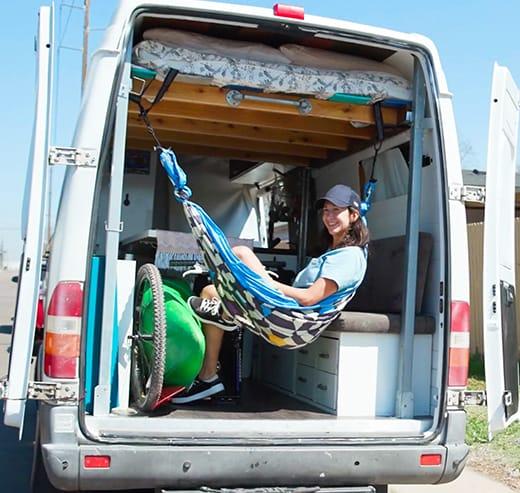 Tatiana relaxes inside her custom van.