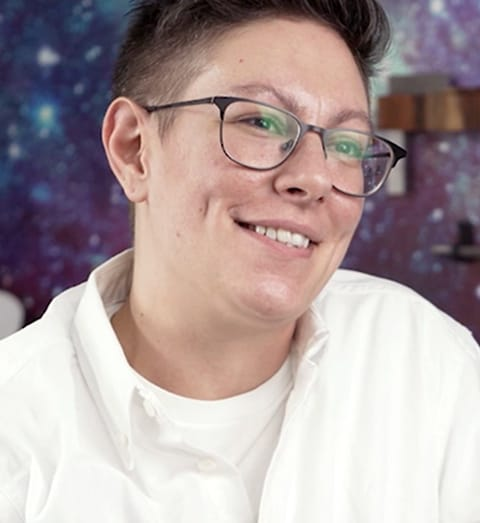 closeup of person wearing a white shirt and glasses