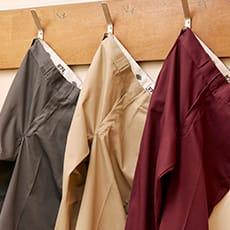 three dickies 874 pants hanging on a wall