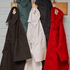 several dickies work shirts hanging on a wall